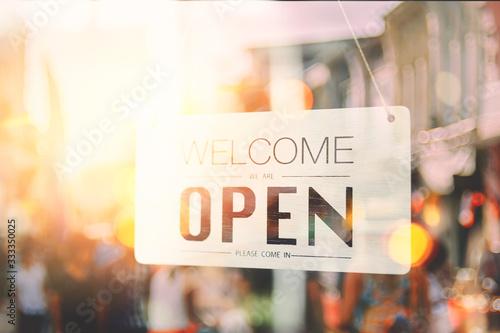 Obraz na plátně Open sign broad hanging on wood door front of cafe.