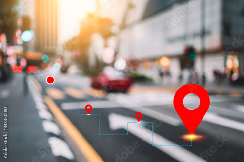 Fotografie, Obraz Blur traffic road and colorful bokeh light and old building town abstract background with navigator gps location