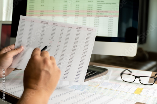 Fototapety, obrazy: Accounting analysis businessman hand working Strategy Research analyzing financial data and charts