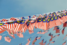 Selective Focused On Small Size Malaysian Flags Tied Together In Large Quantities. Fluttering In The Wind.