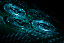 Golden Silver Crypto Currency Coin On Motherboard. Shiny Closeup Crypto-currency Coin Background. Electronic Money, Cryptocurrency.