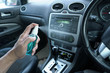Hand of man is spraying alcohol,disinfectant spray in his car,prevent infection of Covid-19 virus,contamination of germs or bacteria,wipe clean surfaces that are frequently touched