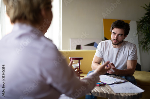 Cuadros en Lienzo Counselor explaining psychotherapy test results to serious client