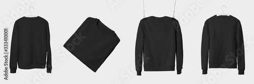 Fotografía Mockup of black textile sweatshirt hanging on a hanger and rope, isolated on a white background
