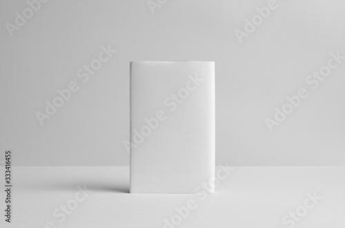 Photo Hardcover Book Mock-Up - Dust Jacket. Backside. Wall Background