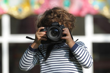Child Learns To Take Pictures ...