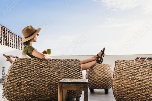 Fototapeta Young woman resting on terrace at home, beautiful girl enjoying life, vacations, relaxation and summer fun concept obraz na płótnie