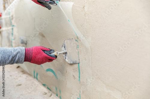 construction worker installing fiberglass plaster mesh on the wall Wallpaper Mural