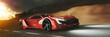 Roter Sportwagen fährt schnell abends auf Straße