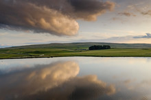 Clouds Reflecting In Water On Malham Tarn, Yorkshire Dales National Park