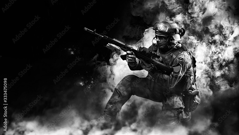 Fototapeta Portrait of a special forces soldier who reloads an assault rifle. The concept of military units. Computer games.