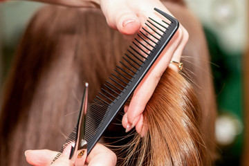 Woman receiving haircut.