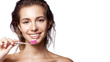 Young Woman Holding Toothbrush...