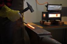Blacksmith Working On Anvil Wi...
