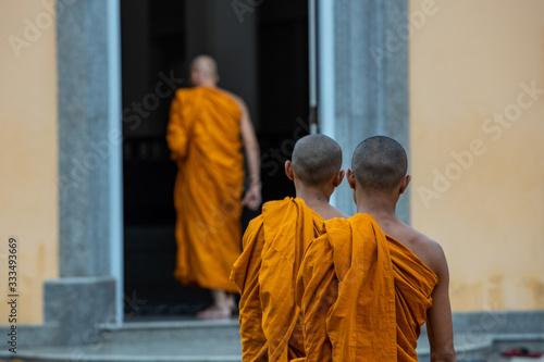 Fototapeta Buddhist monks going inside the temple