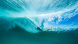 canvas print picture - surfer on a wave from below