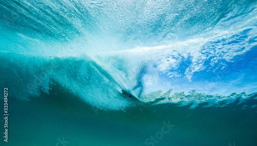 surfer on a wave from below Fotobehang