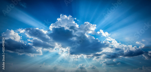 Bright sun shining in clouds on sky Poster Mural XXL