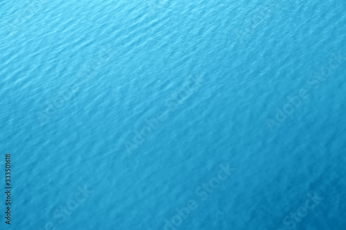 Fototapeta blue water background texture of sea surface top down view Natural color of ocean aqua with waves Backdrop for design obraz