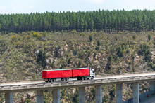 Bloukrans Bridge, Eastern Cape, South Africa. Dec 2019. Bloukraans Bridge Carrying A Toll Road 216 Metres Above The Gorge  Passing Over A Red Truck And Trailer.
