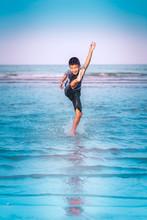 Asian Boy Is Kicking Splashing...