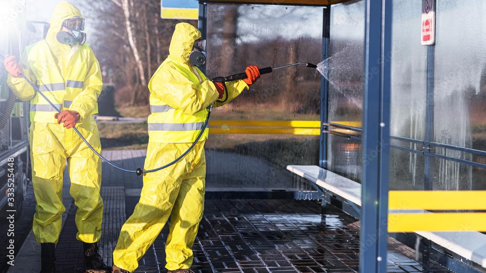 Fototapeta disinfection of public places - coronavirus epidemic - city cleaning