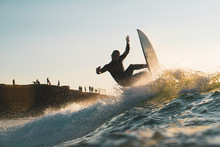 Surfer Rides A Wave At Sunset Cliffs San Diego