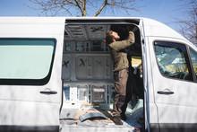 Man Beginning Work On His Self Made Camper Van