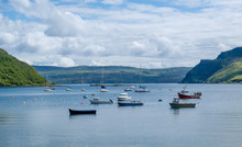 Portree Harbor With Small Boat...