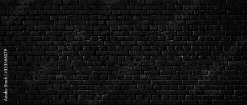 Obraz Texture of a black brick wall as a background or wallpaper - fototapety do salonu
