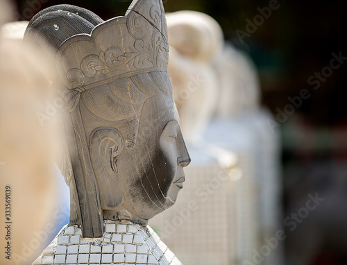 A closeup photo captures a stone statue  at a Buddhist shrine at Repulse Beach, Hong Kong Fototapeta