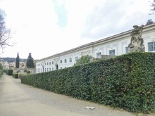 Large White Building Surrounded By Green Plants In Florence, Italy
