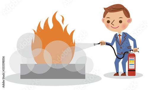 Photo 消火訓練を行うビジネスマン