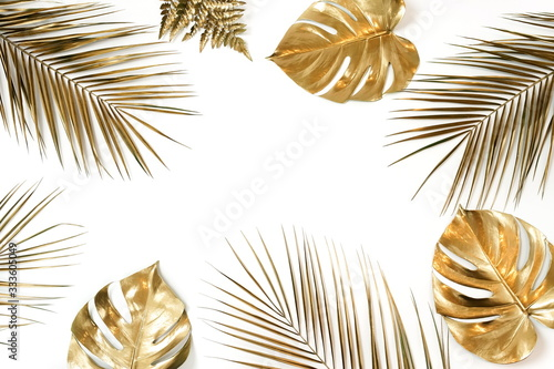 Fotografía Gold palm and monstera leaves plant pattern frame isolated on a white background