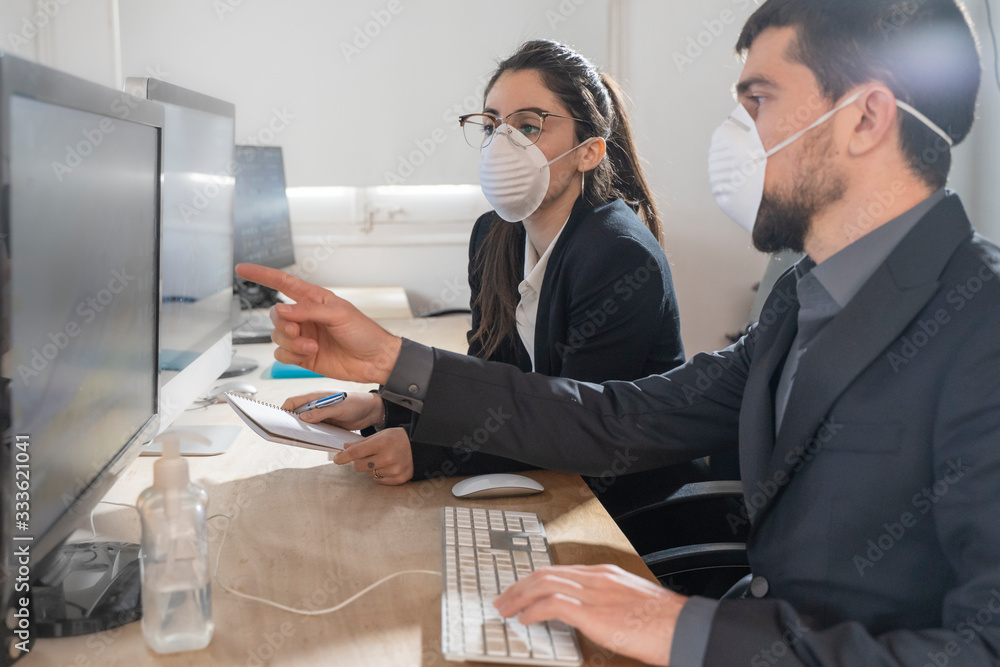 Fototapeta Coronavirus office workers with mask for corona virus. Business workers wear masks to protect and take care of their health. Office working with computer. Working from home. Outbreak lockdown