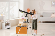 Cute Little Traveler With Telescope At Home