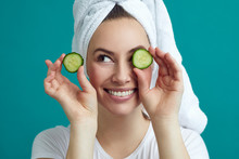 Wellness Concept Of Beautiful Young Woman Holding Cucumbers In Front Of Her Eyes