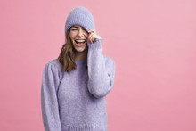 Portrait Of Young Woman In A Nice Winter Sweater That Matches The Background