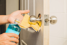 Hand Cleaning Door Knob With A...
