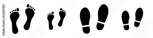 Fototapeta Different human footprints. Baby footprint - stock vector. Shoes for children and adults, adults and children's steps. obraz