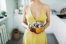 Woman In Yellow Dress Holding ...