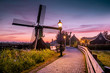canvas print picture - Sunrise Zaanse Schand Dutch windmill village, Windmill village Zaanse Schans, green wooden house at the windmill village zaanse schans Netherlands, Zaanse Schans in the evening during sunset