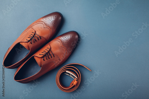 Fototapeta Oxford male brogues shoes with accessories. Men's fashion. Classical brown leather footwear with belt. Space obraz