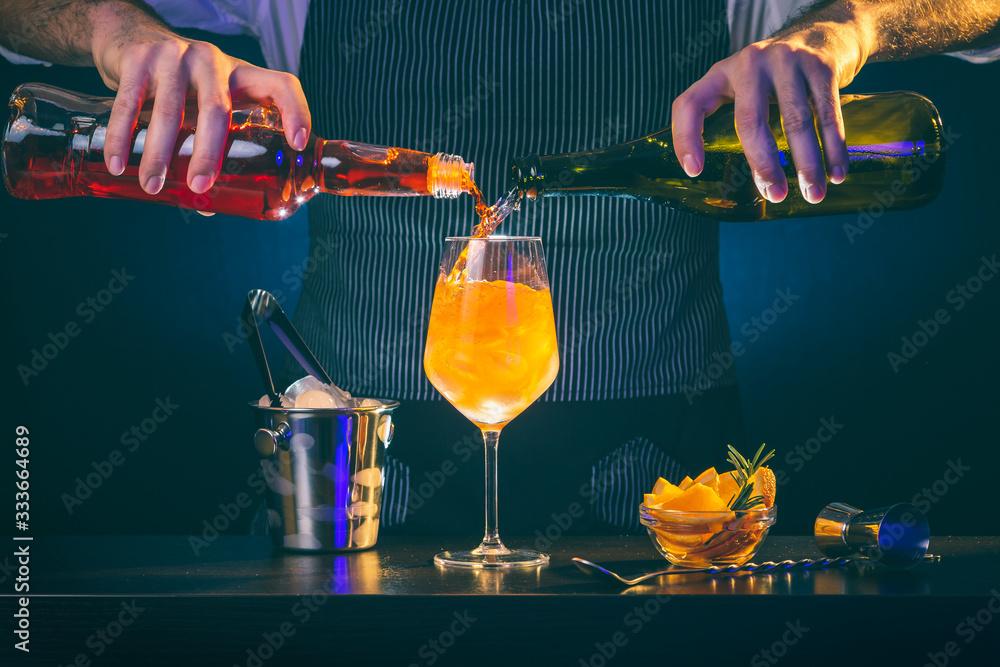 Fototapeta Bartender making Aperol spritz cocktail