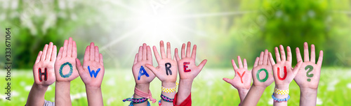 Obraz Children Hands Building Colorful English Word How Are You. Sunny Green Grass Meadow As Background - fototapety do salonu