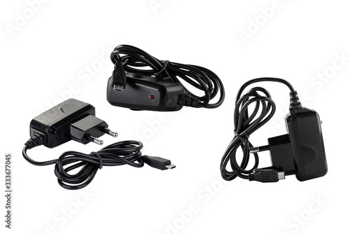 Leinwand Poster Black power adapter with micro-USB cable isolated on white