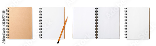 Fotografia Set of notebooks on white background, top view. Banner design