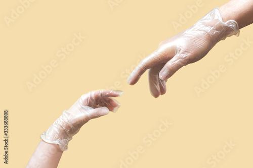 creation of Adam like hands wearing latex gloves on beige background Wallpaper Mural