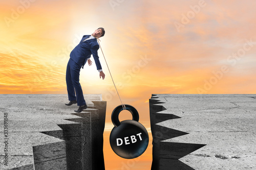Fotografia Concept of debt and load with businessman