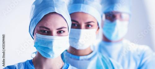 Obraz Team surgeon at work in operating room - fototapety do salonu